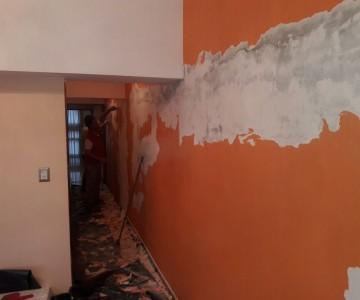 revestimiento con placas antihumedad, pared en habitacion casa de familia. en Venado Tuerto